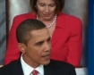 President Obama reacting to the passage of the House Bill while House Speaker Nancy Pelosi stands in the background.