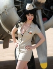 pin up girl in front of plane