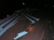 Photo of pipe strewn across the lanes of Highway 22E in Oregon 5-6-08