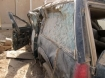 Military contractor truck that was severely damaged in an explosion in Iraq, probably a roadside bomb or IED.