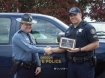 Captain Jeff Samuels, OSP Fish and Wildlife Division Director, presented Senior Trooper James Halsey the Division award during a Mid-Valley Team meeting at the OSP Albany Area Command office