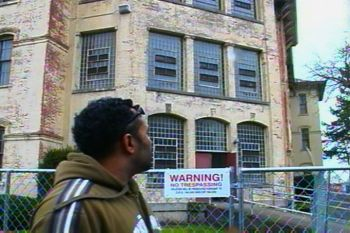 Bernard Powell of Salem, Oregon gazes at one of the state hospital's oldest buildings