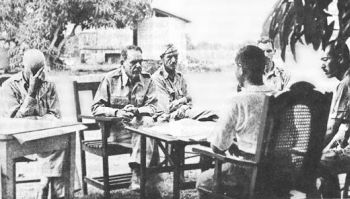 Gen. Edward King surrenders to the Japanese.