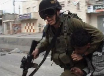 "Image from ""A People Without a Land"" shows Israeli soldier dragging Palestinian boy in a headlock."
