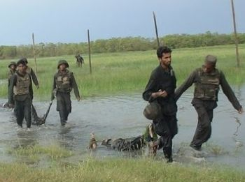 Sri Lankan government forces drag corpses of Tamil Tigers.