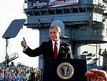 President George W. Bush speaks triumphantly before the