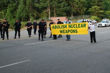 Photo of action attached (photo credit: Leonard Eiger, Ground Zero Center for Nonviolent Action).