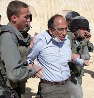 Salem-News.com writer, Professor Mazin Qumsiyeh, a former Duke and Yale professor, is hauled away by Israeli soldiers for taking part in a peace demonstration.