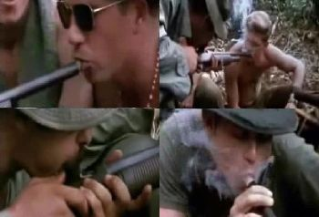 US Soldiers Smoke Pot Through an Unloaded Shot Gun during The Vietnam War.