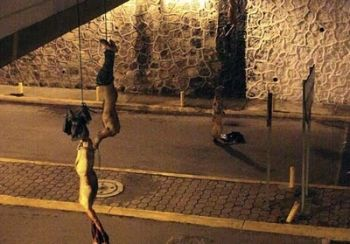 Image of four headless men hanging upsidedown Courtesy: Cuernavaca