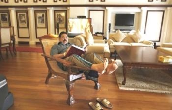 Rajapaksa relaxing in his reading room.