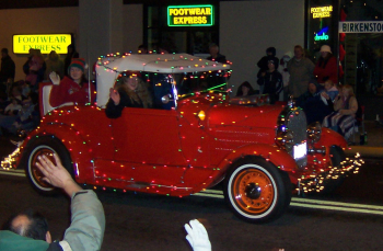 red car in lighted parade