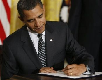 America's corporate president signs the defense bill that he said initially he would veto.
