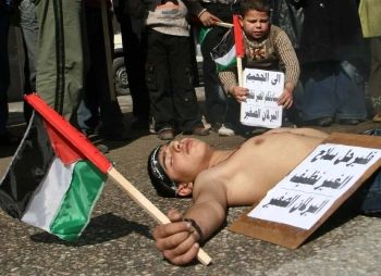 Palestinian children feigning death during a protest against internal fighting in Rafah Refugee Camp