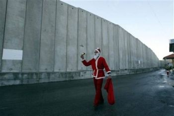 Santa on a street with no name, in the little town of Bethlehem. Claire's Tomb [home and business] are at the end of the alley.