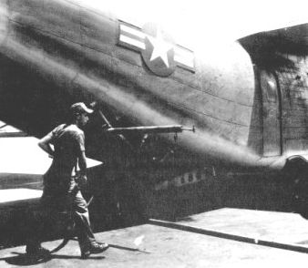 U.S. airman preparing a plane loaded with Agent Orange prior to a mission over Vietnam.