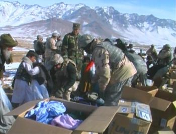 File photo of Afghan high country refugees receiving aid by Tim King Salem-News.com