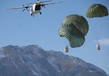 Blackwater CASA 212 over Afghanistan dropping supplies to U.S. Army troops