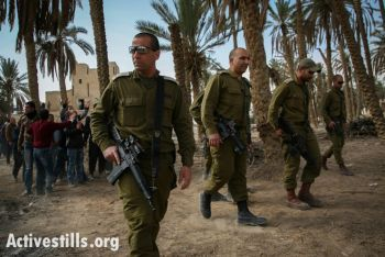 Israeli soldiers patrol in the Ein Hijleh protest camp, Jordan Valley, West Bank, February 5, 2014. (photo: Activestills.org)