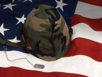 American flag and miiltary helmet