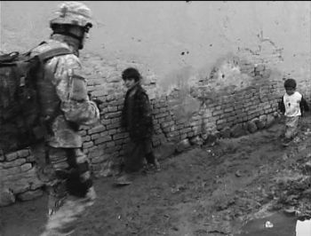 U.S. soldier passing children in Afghanistan