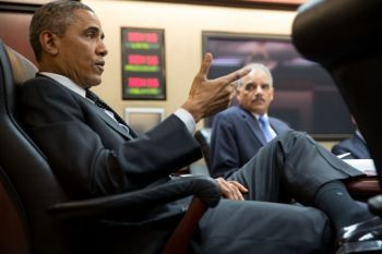President Barack Obama, with Attorney General Eric H. Holder, Jr., holds a meeting with intelligence community leaders in the Situation Room of the White House, Jan. 8, 2014. (Official White House Photo by Pete Souza)