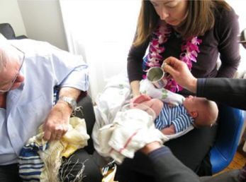 At the Bris Shalom, the parents washed their son's feet (Brit Rechitzah) as a symbolic sign of Jewish covenant