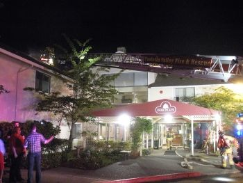 Firefighters enter the Park Place Assisted Living Community in Tualatin, Oregon, where a fire displaced 80 residents. Photo: Brian Barker/TFV&R Fire