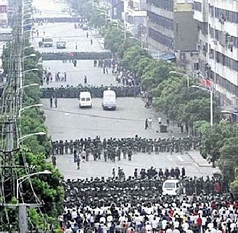 Chinese riot police face demonstrators in Urumqi, July 5th.