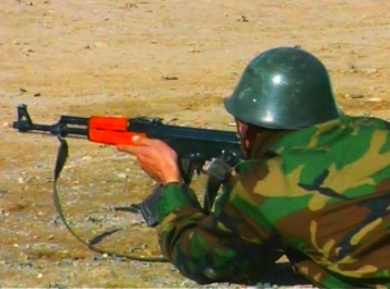 Afghan National Army soldier with his AK-47