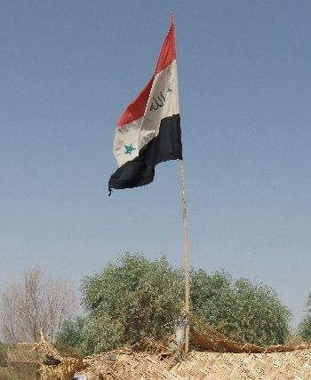 Iraqi flag at a security checkpoint near Balad.