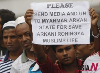 A Myanmar ethnic Rohingya Muslim holds a placard
