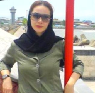 This woman in Tehran is wearing a hijab.