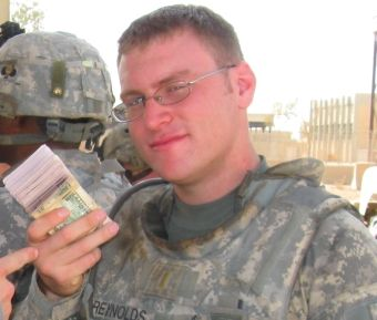 A U.S. Army Lieutenant with the 101st Airborne in Iraq preparing to pay former insurgents for their work with U.S. forces.