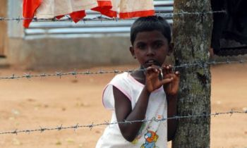 Tamil boy inside a Tamil refugee camp Courtesy: trendsupdates.com