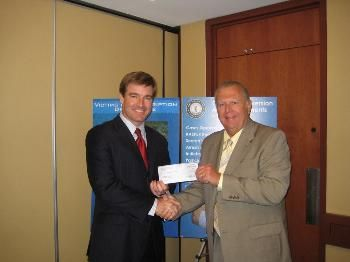 NADDI President John Burke presents Attorney General Conway with a Seed Grant for $50,000