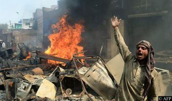 Homes burning in Joseph Colony