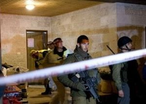 Israeli officials at the scene of the tragic murder of the Fogel family in an Israeli settlement