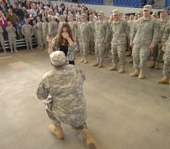 Oregon soldier, Garen Hart, of Sherwood, Ore., proposes to his fiancé, Melinda Morris, of Portland