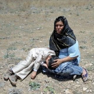 Afghan woman and child harmed from war