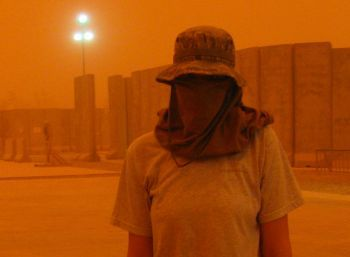 Female U.S. soldier during a sandstorm in Iraq
