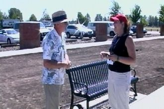 Patty Louisiana talking to another organizer at the Traveling Wall event last summer