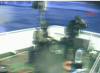 Video frame shows Israeli commandos on the deck of the the same vessel they shot several people aboard.