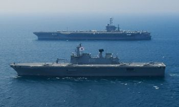 "Republic of Korea Ship (ROKS) Dokdo (LPH 6111) steams alongside USS George Washington (CVN 73) in the Sea of Japan during operation ""Invincible Spirit."