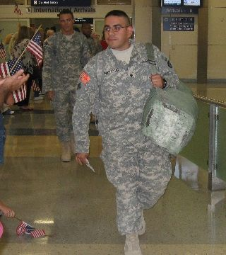 Soldiers coming off the plane from Iraq at the Dallas Airport.