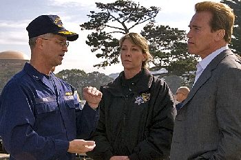 Rear Admiral Craig Bone (left), commander of the Eleventh Coast Guard District, explains the details of the Cosco Busan incident in the San Francisco Bay to California Governor Arnold Schwarzenegger.