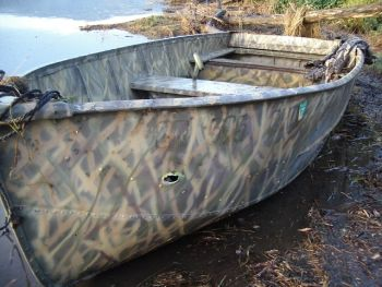 Duck hunting boat with shotgun blast in Tillamook Bay, Oregon