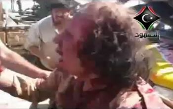 Col. Gaddafi being dragged off to his death in the bands of so-called rebel fighters, who are financed by NATO.