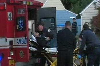 shooting victim being loaded into ambulance
