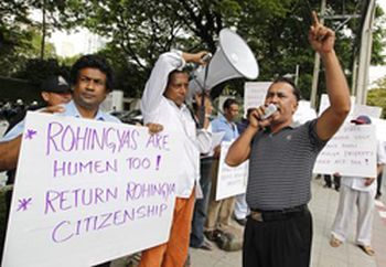 Ethnic Rohingya Muslim refugees from Myanmar hold placards and shout slogans during a rally in front of the US embassy in Bangkok on Wednesday, calling for international intervention.